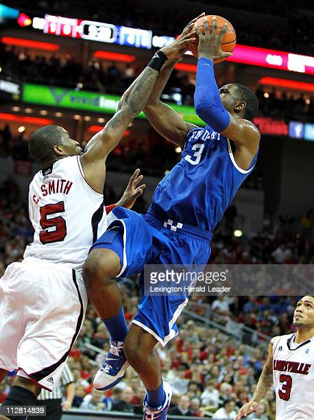 Kentucky forward Terrence Jones puts in a shot over Louisville guard Chris Smith during game action at the KFC Yum Center in Louisville Kentucky...