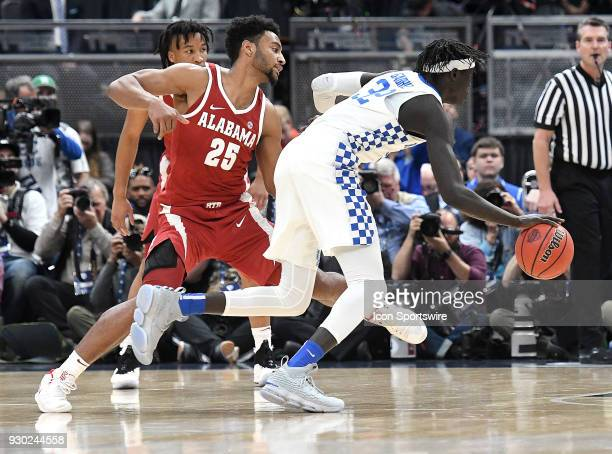 Kentucky forward Wenyen Gabriel drives around Alabama forward Braxton Key during a Southeastern Conference Basketball Tournament game between the...