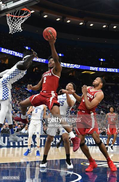 Kentucky forward Wenyen Gabriel tries to block a shot by Alabama guard Collin Sexton during a Southeastern Conference Basketball Tournament game...
