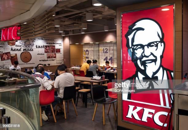 Kentucky Fried Chicken brand logo and restaurant in Mong Kok Hong Kong