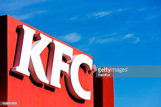 kentucky fried chicken sign over suburban branch - kentucky fried chicken stock photos and pictures