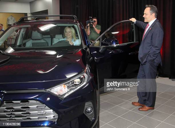 Kentucky Governor Matt Bevin and Toyota Motor Manufacturing Kentucky President Susan Elkington look over the new 2019 Toyota RAV4 Hybrid after they...