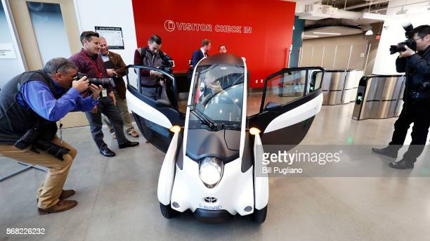 Kentucky Governor Matt Bevin gets photographed by the news media as he sits in a Toyota IRoad aftter the unveiling of a new Toyota engineering...