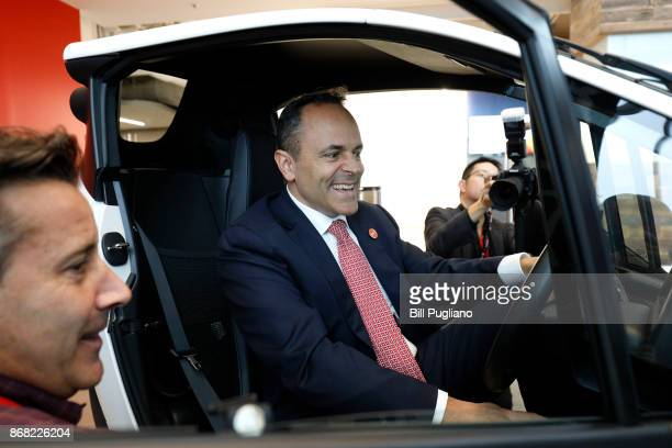 Kentucky Governor Matt Bevin sits in a Toyota IRoad after the unveiling of a new Toyota engineering headquarters October 30 2017 in Georgetown...