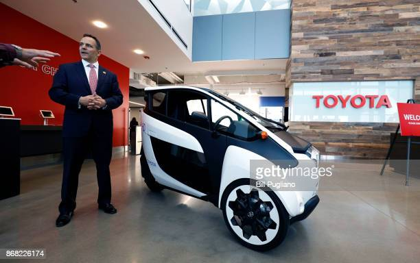 Kentucky Governor Matt Bevin stands next to the Toyota IRoad after the unveiling of a new Toyota engineering headquarters October 30 2017 in...