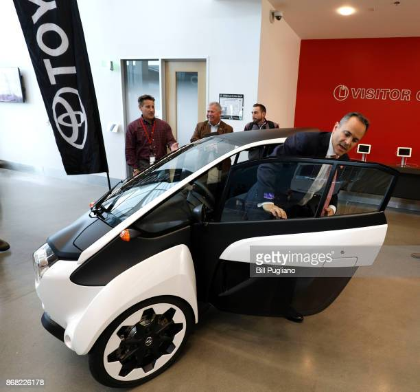 Kentucky Governor Matt Bevin steps out of a Toyota IRoad after the unveiling of a new Toyota engineering headquarters October 30 2017 in Georgetown...