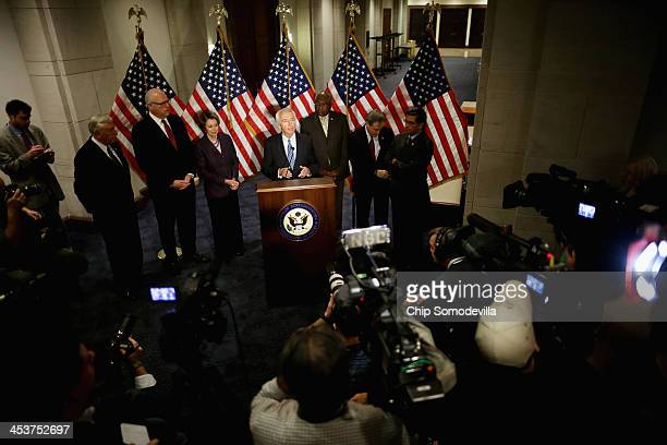 Kentucky Governor Steve Beshear stands with members of the House Democratic leadership as he talks to reporters after attending a caucus meeting in...