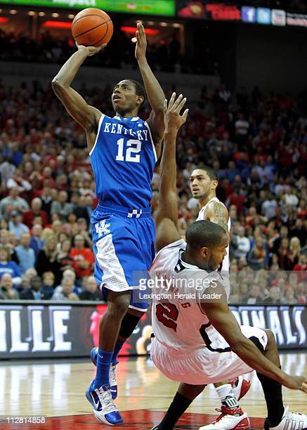 Kentucky guard Brandon Knight gets the basket and a foul on Louisville guard Preston Knowles during game action at the KFC Yum Center in Louisville...