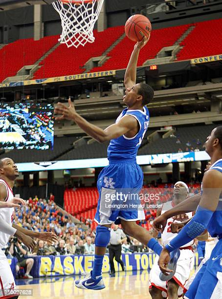 Kentucky guard Brandon Knight goes down the lane for a basket for two against Alabama in the semifinals of the SEC Tournament at the Georgia Dome in...