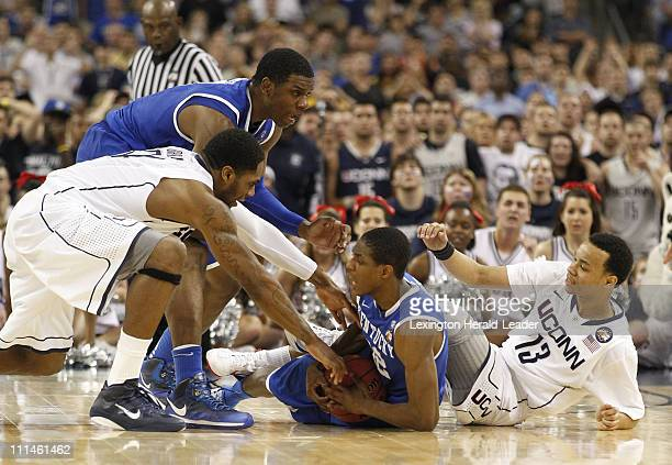 Kentucky guard Brandon Knight holds on the ball during a floor scramble late in the second game of the men's NCAA Final Four semifinals at Reliant...