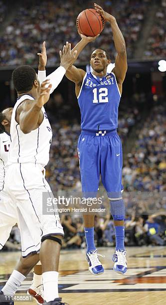 Kentucky guard Brandon Knight puts up a shot against Connecticut during the second in the men's NCAA Final Four semifinals at Reliant Stadium in...