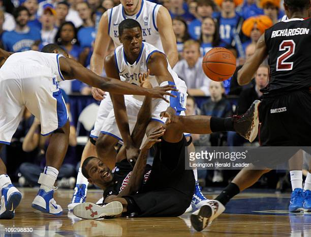 Kentucky guard Darius Miller left and forward Terrence Jones force South Carolina forward Sam Muldrow to get rid of the ball during game action at...