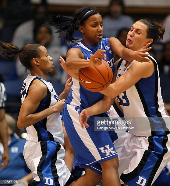 Kentucky guard Maegan Conwright coughs up the ball as Duke guard Jasmine Thomas and teammate Haley Peters defend on the play during firsthalf action...