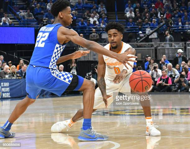Kentucky guard Shal GilgeousAlexander tight guards Tennessee guard Jordan Bone during a Southeastern Conference Basketball Tournament game between...