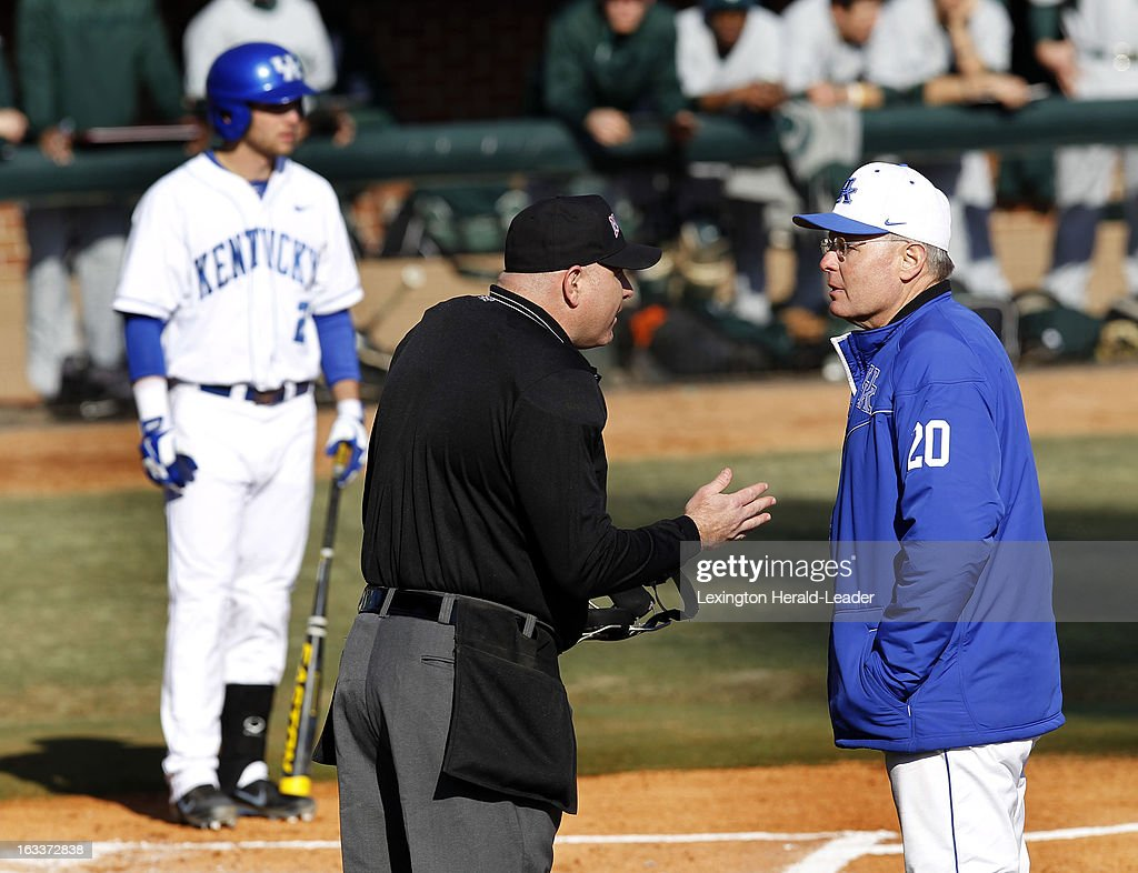Kentucky head coach Gary Henderson argues with home plate umpire John Bennett after Zac Zellers, background, was hit by a pitch in the first inning against Michigan State at Cliff Hagan Stadium in Lexington, Kentucky, on Friday, March 8, 2013.