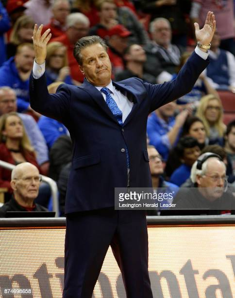 Kentucky head coach John Calipari throws his hands in the air after an official's noncall during a game against Louisville on December 21 in...