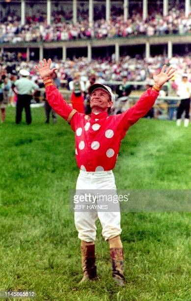Jockey Pat Day looks to the skies after winning his first Kentuky Derby while riding Lil E Tee 02 May 1992 in the 118th running of the race Day who...