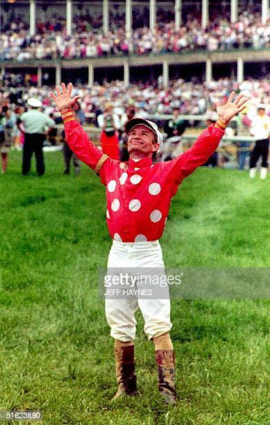 Kentucky Jockey Pat Day looks to the skies after winning his first Kentuky Derby while riding Lil E Tee 02 May 1992 in the 118th running of the race...
