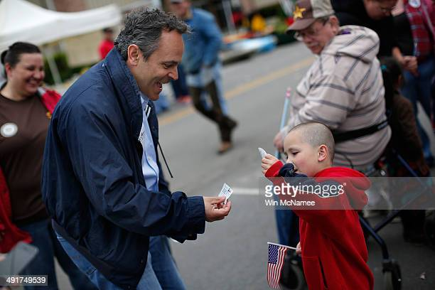 Kentucky Republican senatorial candidate Matt Bevin greets a child at the Fountain Run BBQ Festival while campaigning for the Republican primary May...