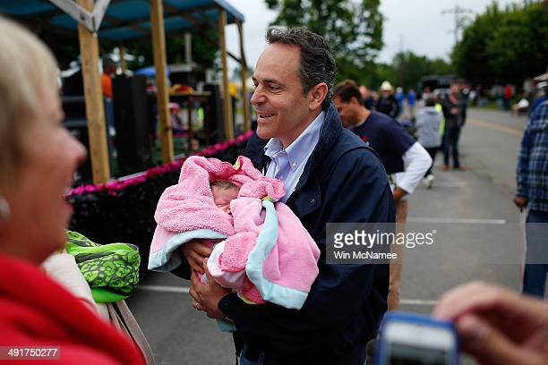 Kentucky Republican senatorial candidate Matt Bevin holds newsborn Mary Halston Brandon at the Fountain Run BBQ Festival while campaigning for the...