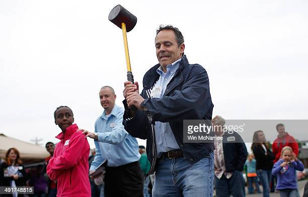 Kentucky Republican senatorial candidate Matt Bevin swings a mallet while ringing the bell on the High Striker game at the Fountain Run BBQ Festival...