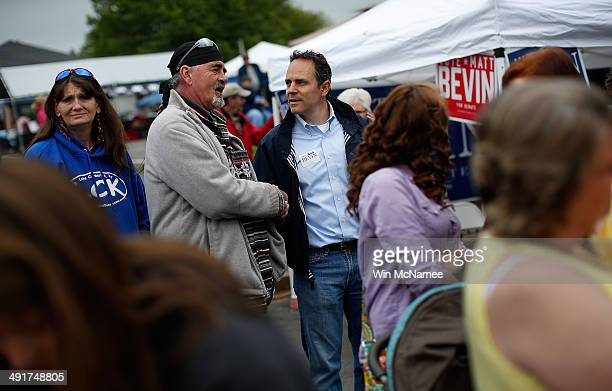 Kentucky Republican senatorial candidate Matt Bevin talks with voters at the Fountain Run BBQ Festival while campaigning for the Republican primary...