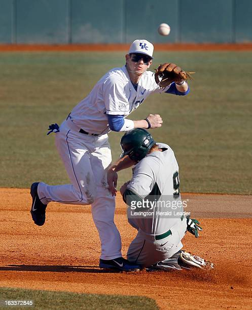 Kentucky second baseman JT Riddle forces Michigan State's Jimmy Pickens at second base on the front end of an inningending double play in the second...