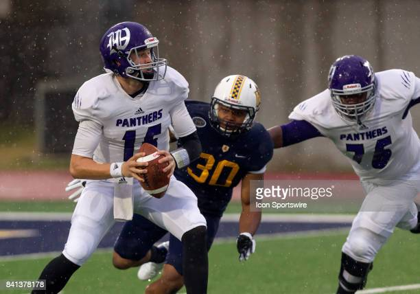 Kentucky Wesleyan quarterback Mike McGee does not see he is about to be sacked by Murray State defensive lineman Kenney Wooten during the college...