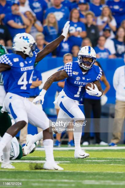Kentucky wide receiver Lynn Bowden Jr runs around the end during a regular season college football game between the Eastern Michigan Eagles and the...