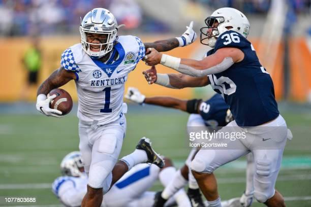 Kentucky wide receiver Lynn Bowden Jr stiffarms Penn State linebacker Jan Johnson during the second half of the Citrus Bowl between the Kentucky...