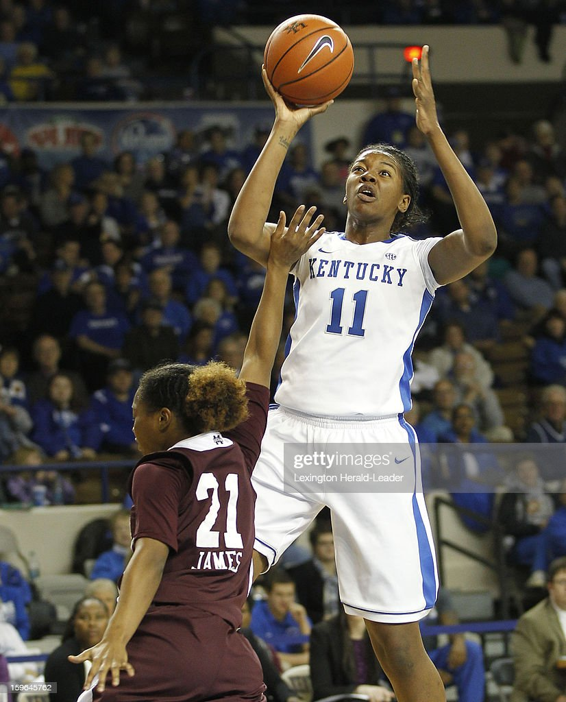 Kentucky Wildcats center DeNesha Stallworth (11) put in a shot over Mississippi State Bulldogs guard Jerica James (21) during a women's college basketball game at Rupp Arena on Thursday, January 17, 2013 in Lexington, Kentucky.