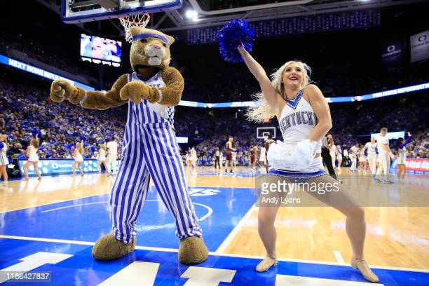 Kentucky Wildcats cheerleader and the mascot perform in the game against the Eastern Kentucky Colonels at Rupp Arena on November 08 2019 in Lexington...