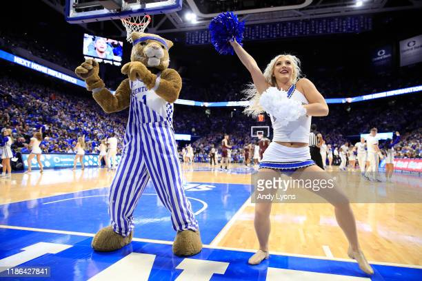 Kentucky Wildcats cheerleader and the mascot perform in the game against the Eastern Kentucky Colonels at Rupp Arena on November 08, 2019 in...
