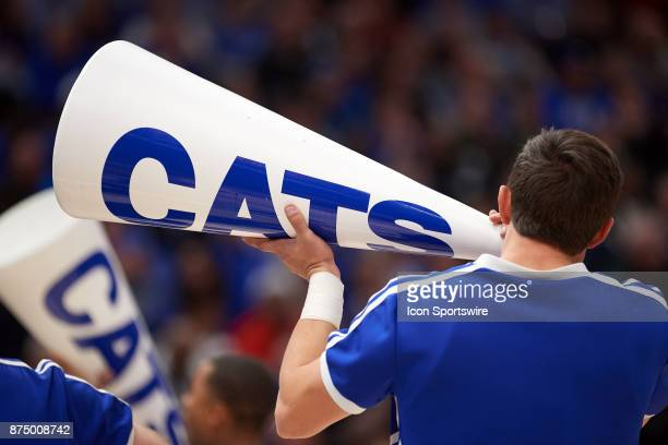 Kentucky Wildcats cheerleader cheers into a megaphone with the word Cats on it is seen during the State Farm Classic Champions Classic game between...