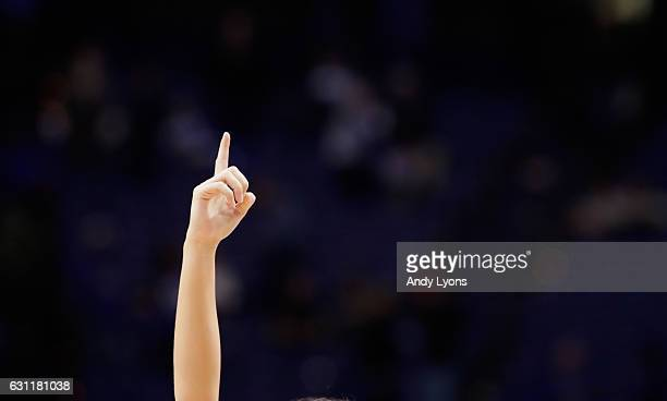 Kentucky Wildcats cheerleader holds up a finger after the game against the Arkansas Razorbacks at Rupp Arena on January 7 2017 in Lexington Kentucky