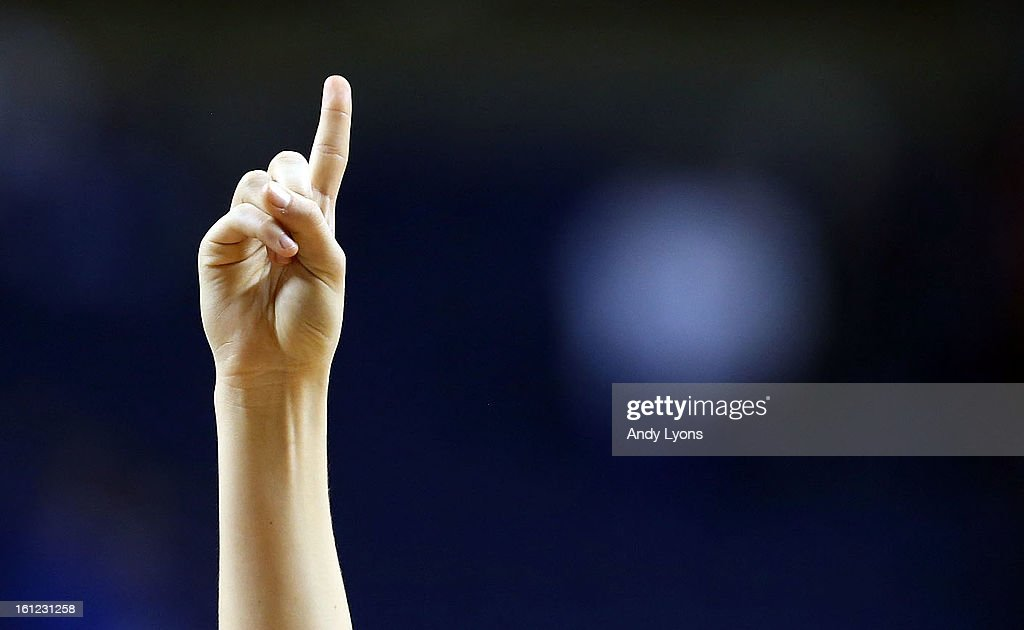 A Kentucky Wildcats cheerleader holds up one finger after the game against the Auburn Tigers at Rupp Arena on February 9, 2013 in Lexington, Kentucky.