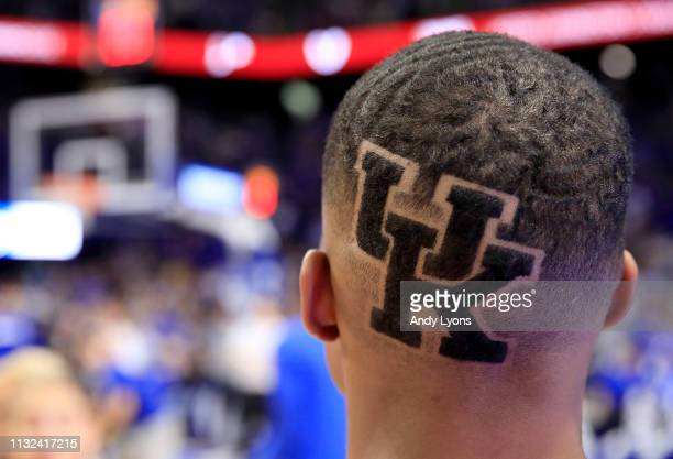 Kentucky Wildcats cheerleader show his support during the game against the Arkansas Razorbacks at Rupp Arena on February 26, 2019 in Lexington,...