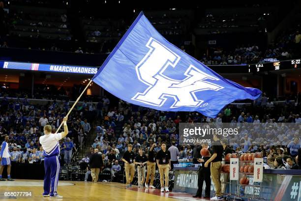 Kentucky Wildcats cheerleader waves a flag at the start of the second half against the North Carolina Tar Heels during the 2017 NCAA Men's Basketball...