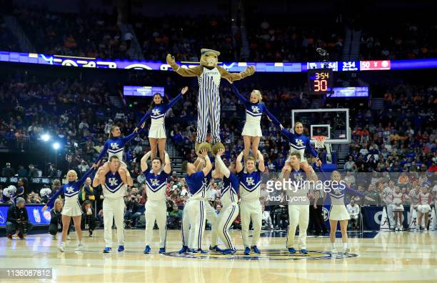 Kentucky Wildcats cheerleaders perform against the Alabama Crimson Tide during the Quarterfinals of the SEC Basketball Tournament at Bridgestone...
