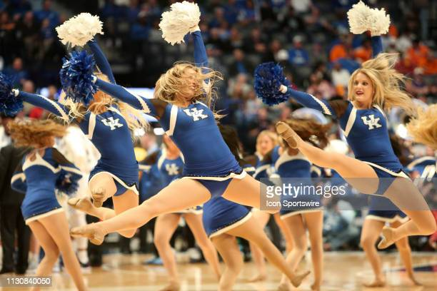 Kentucky Wildcats cheerleaders perform during a Southeastern Conference Tournament game between the Kentucky Wildcats and Alabama Crimson Tide March...