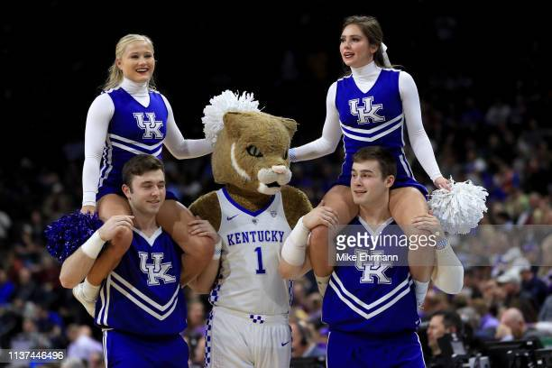 Kentucky Wildcats cheerleaders perform during the first round of the 2019 NCAA Men's Basketball Tournament at Jacksonville Veterans Memorial Arena on...