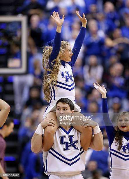 Kentucky Wildcats cheerleaders perform during the game against the Kansas Jayhawks in the State Farm Champions Classic at Bankers Life Fieldhouse on...