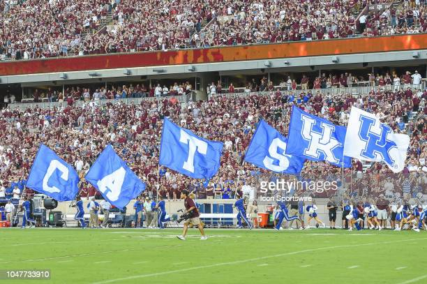Kentucky Wildcats cheerleaders run onto the field before the game between the Kentucky Wildcats and Texas AM Aggies on October 6 2018 at Kyle Field...