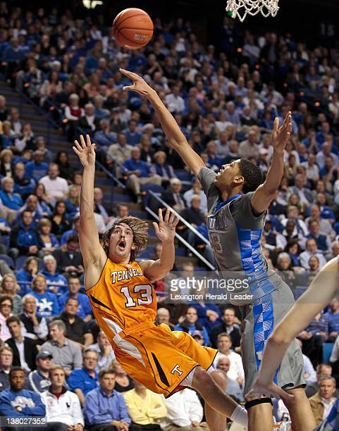 Kentucky Wildcats forward Anthony Davis blocks a shot by Tennessee Volunteers guard Skylar McBee during the first half at Rupp Arena in Lexington...