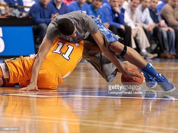 Kentucky Wildcats forward Anthony Davis goes for a loose ball with Tennessee Volunteers guard Trae Golden during game action at Rupp Arena in...
