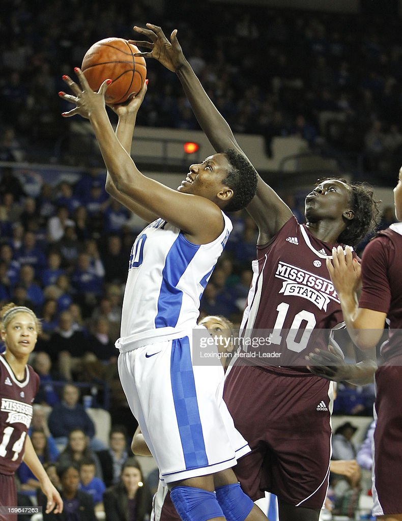 Kentucky Wildcats forward Brittany Henderson (40) puts in a shot over Mississippi State Bulldogs center Martha Alwal (10) during a women's college basketball game at Rupp Arena on Thursday, January 17, 2013 in Lexington, Kentucky. Kentucky defeated Mississippi State, 100-47.