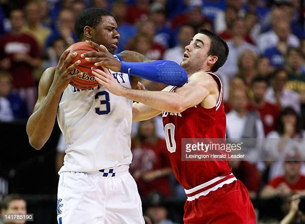 Kentucky Wildcats forward Terrence Jones and Indiana Hoosiers guard Matt Roth scrap for a loose ball during the first half of an NCAA Tournament...