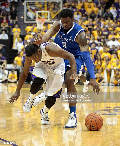 Kentucky Wildcats forward Terrence Jones and LSU Tigers guard Andre Stringer chased down a loose ball during game action at Pete Maravich Assembly...