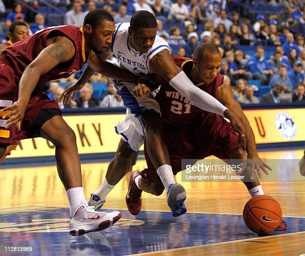 Kentucky Wildcats forward Terrence Jones fought for a loose ball with Winthrop Eagles guard Andre Jones Wednesday December 22 2010 in Lexington...