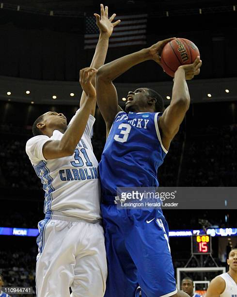 Kentucky Wildcats forward Terrence Jones put in two of his 11 points over North Carolina Tar Heels forward John Henson during the Elite 8 of the...